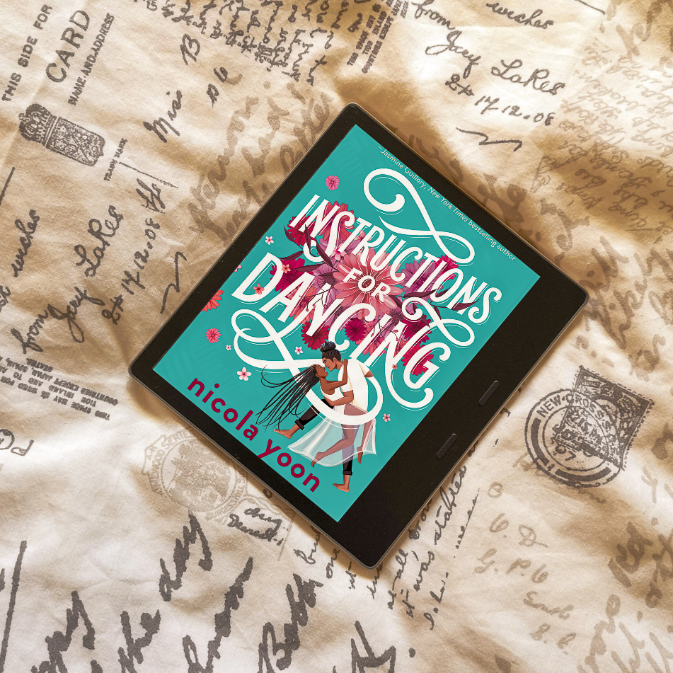 An e-reader wit the Instructions for Dancing book cover. The cover has a turquoise background with the title in white font, and in the bottom right there is a drawing of a heterosexual black couple.